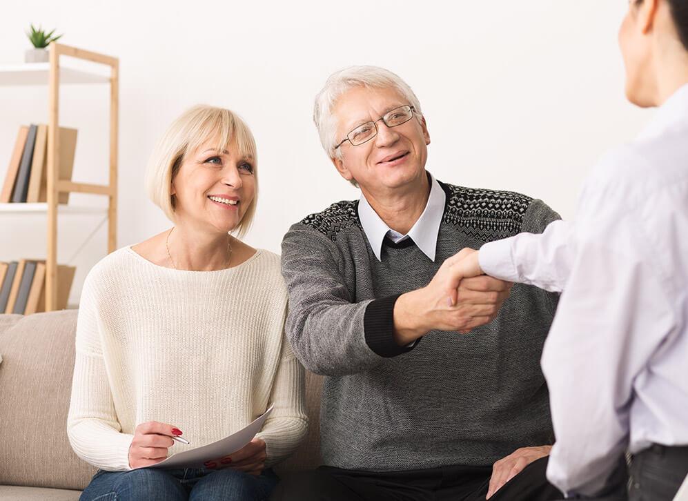 Caregiver helping seniors