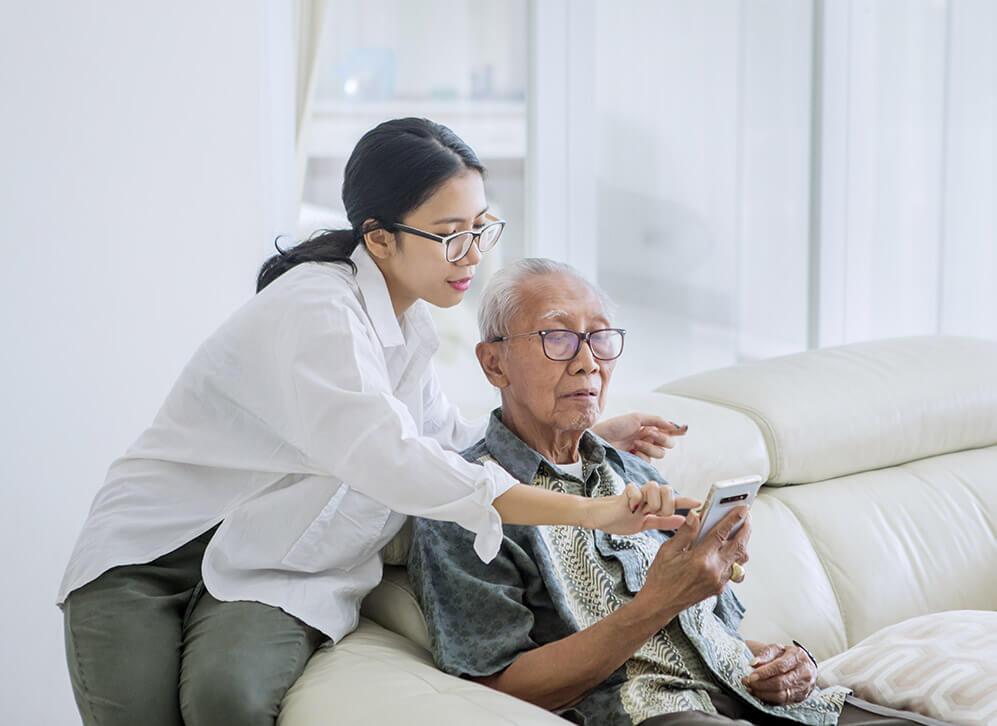Caregiver assisting senior
